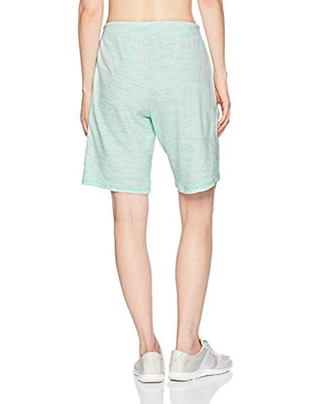 5cca4603c4e Lyst - Danskin Essential Bermuda Short in Green