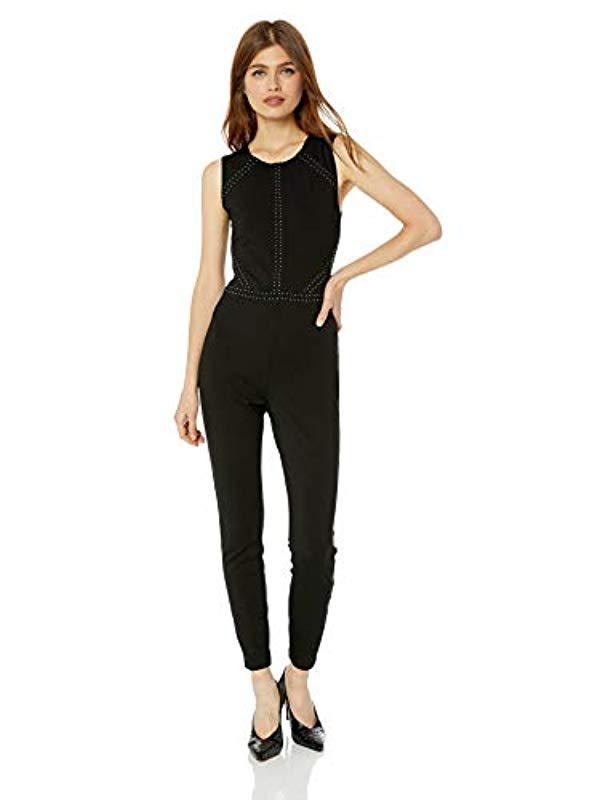 1278d3d724c8 Lyst - Guess Sleeveless Adora Studded Jumpsuit in Black