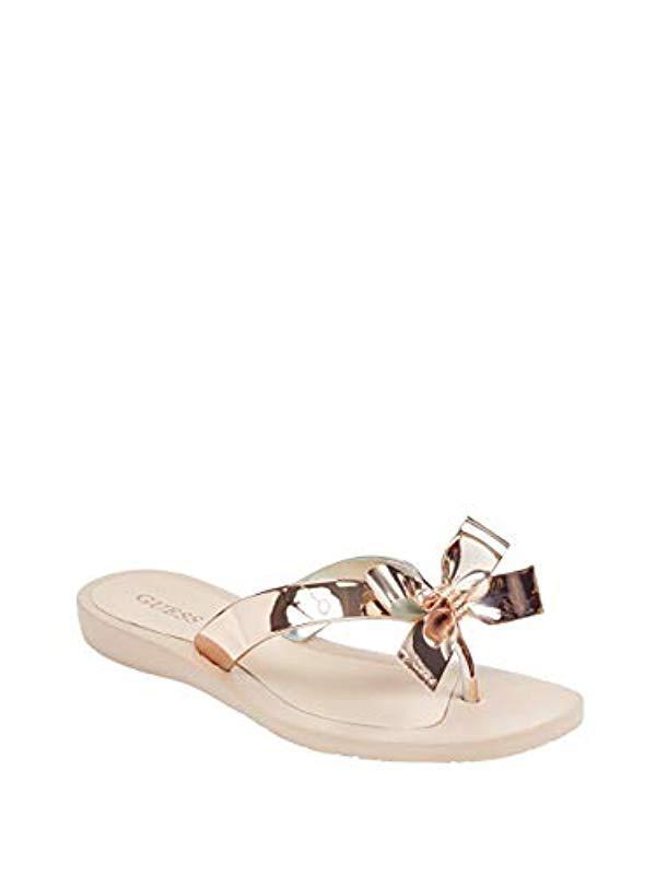 11dca5f2bcd4aa Guess. Women s Metallic Tutu9 Flat Sandal.  35 From Amazon ...