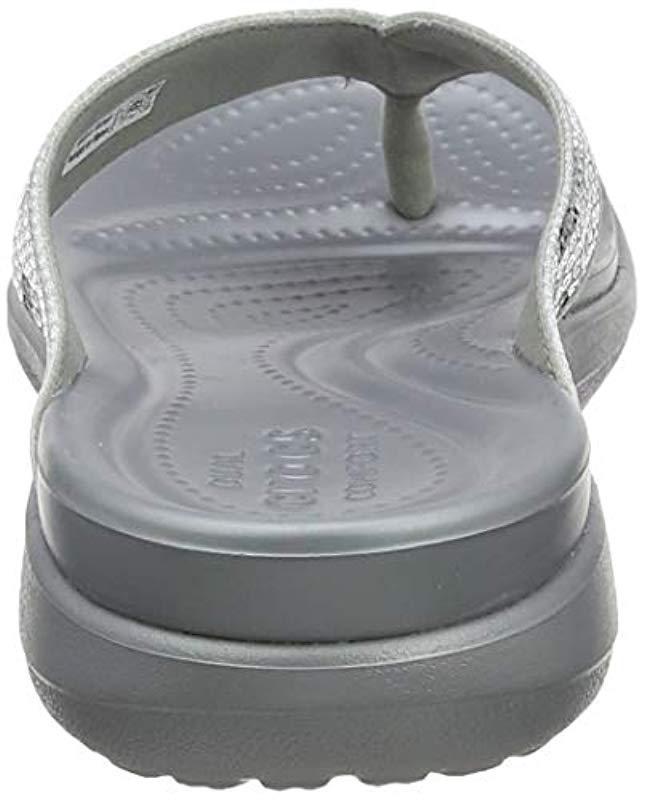 6510e35e939f Lyst - Crocs™ Capri V Sequin Flip Flops in Metallic - Save 14%