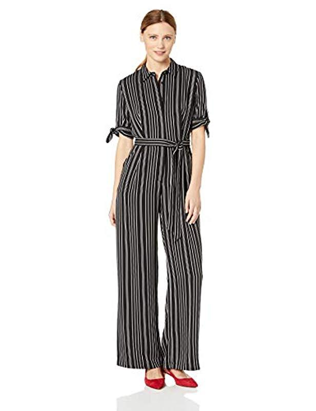 c7e5e199597 Lyst - Calvin Klein Long Sleeve Jumpsuit With Self Belt in Black