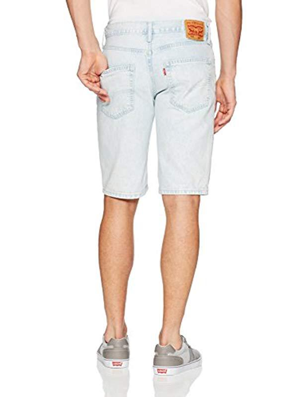 23a82347 Lyst - Levi's 502 Regular Taper Long Shorts in Blue for Men - Save  15.555555555555557%
