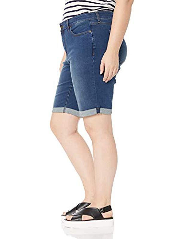 d758a0baaf5 Lyst - NYDJ Plus Size Briella Roll Cuff Jean Short in Blue