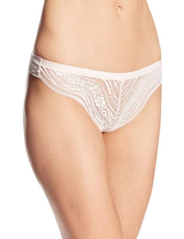 aeb26ada585 Lyst - Calvin Klein Infinite Lace Thong Panty in Natural