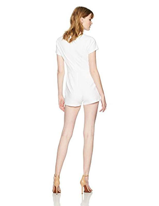 33d0fa7059c6 Lyst - Guess Short Sleeve Arabella Lace Mix Romper in White - Save 36%