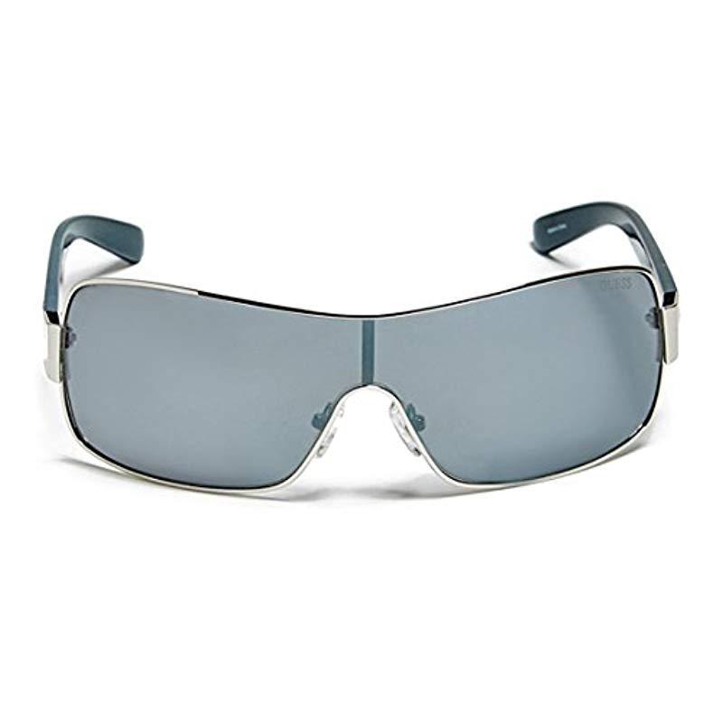 b829a08d1f Hombre Mixed escudo gafas de sol Guess de hombre de color Azul - Lyst