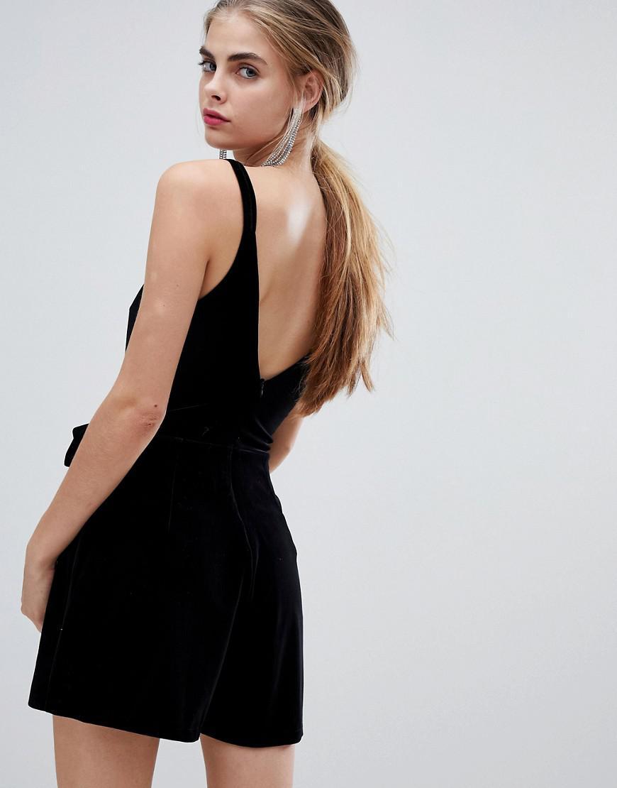 55c76e43a6 Lyst - Bershka Embellished Buckle Velvet Playsuit in Black