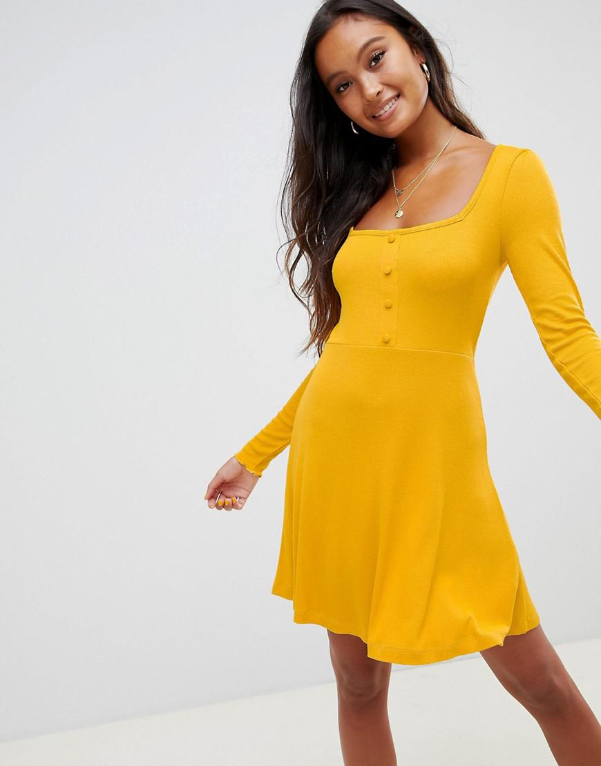 73727fa34e48 ASOS Mini Skater Dress In Rib With Button Front in Yellow - Lyst