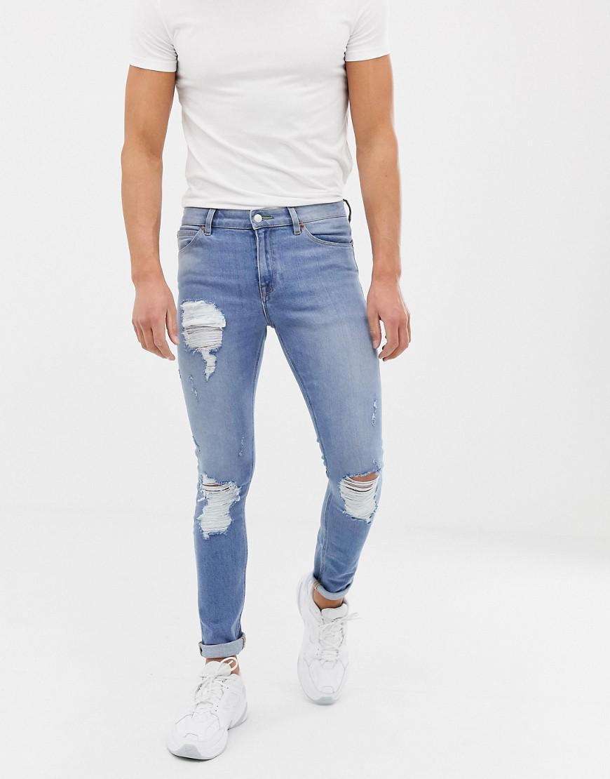1ba322e57dd ASOS. Men's Blue 12.5oz Super Skinny Jeans In Vintage Light Wash With Heavy  Rips
