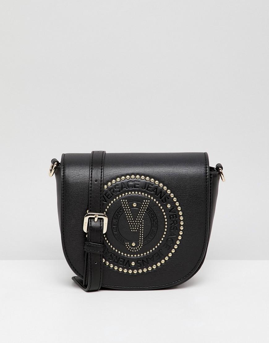 Versace Jeans Embossed Logo Saddle Crossbody Bag in Black - Lyst dfd2c5487d
