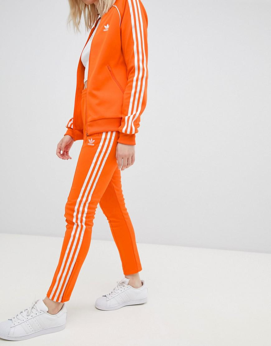 adidas Originals Three Stripe Cigarette Pants In Orange - Lyst