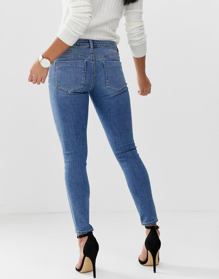 0d936beaf Lyst - ASOS Asos Design Petite Whitby Low Rise Skinny Jeans In Mid Wash Blue  in Blue
