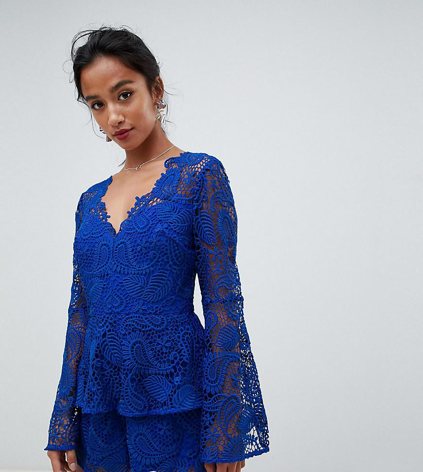 7aefbbca05 ASOS. Women s Blue Asos Design Petite Lace Playsuit With Ruffle Tiers And Fluted  Sleeve