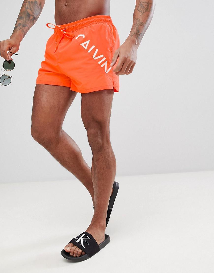 2d1222b7bcd Calvin Klein Short Logo Swim Shorts in Orange for Men - Lyst