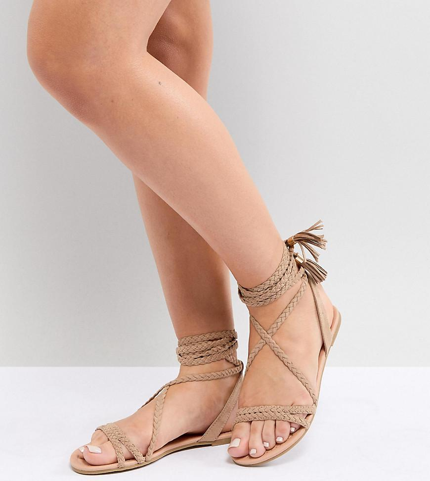 d6eba00a33e ASOS Fayla Wide Fit Tie Leg Plaited Flat Sandals in Natural - Lyst