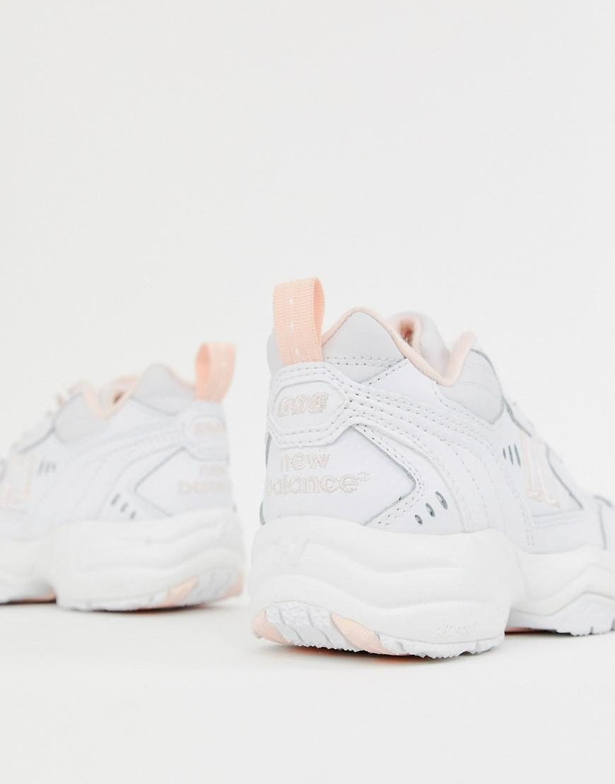 cheap for discount 50a5b a19d9 New Balance 608 White And Pink Chunky Trainers in White - Lyst