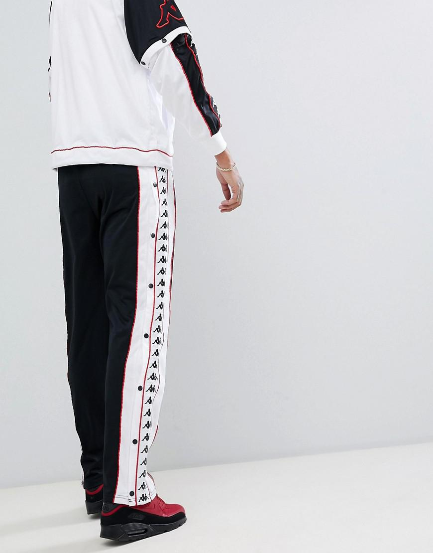 dda90fad144 Kappa joggers With Popper Side Fastening And Logo Taping In Black in ...