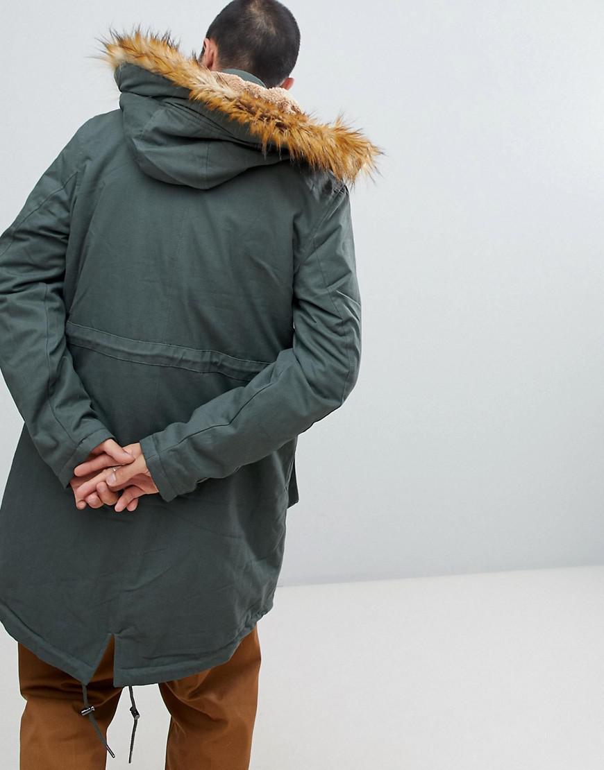 fda9281d2bca asos-green-Parka-paisse-avec-doublure-en-imitation-peau -de-mouton-et-bordure-en-fausse-fourrure.jpeg