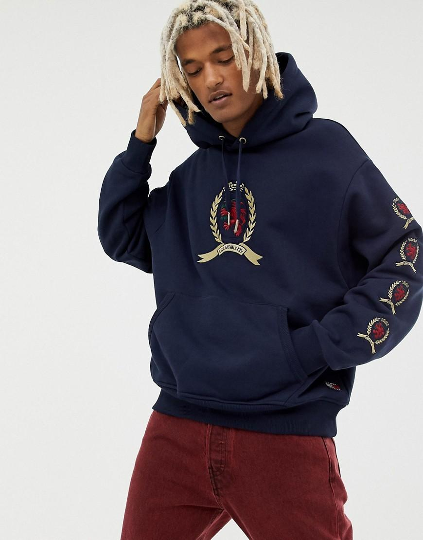 dfde2a3c58202f Tommy Hilfiger. Men s Blue 6.0 Limited Capsule Hoodie With Repeat Crest Logo  ...