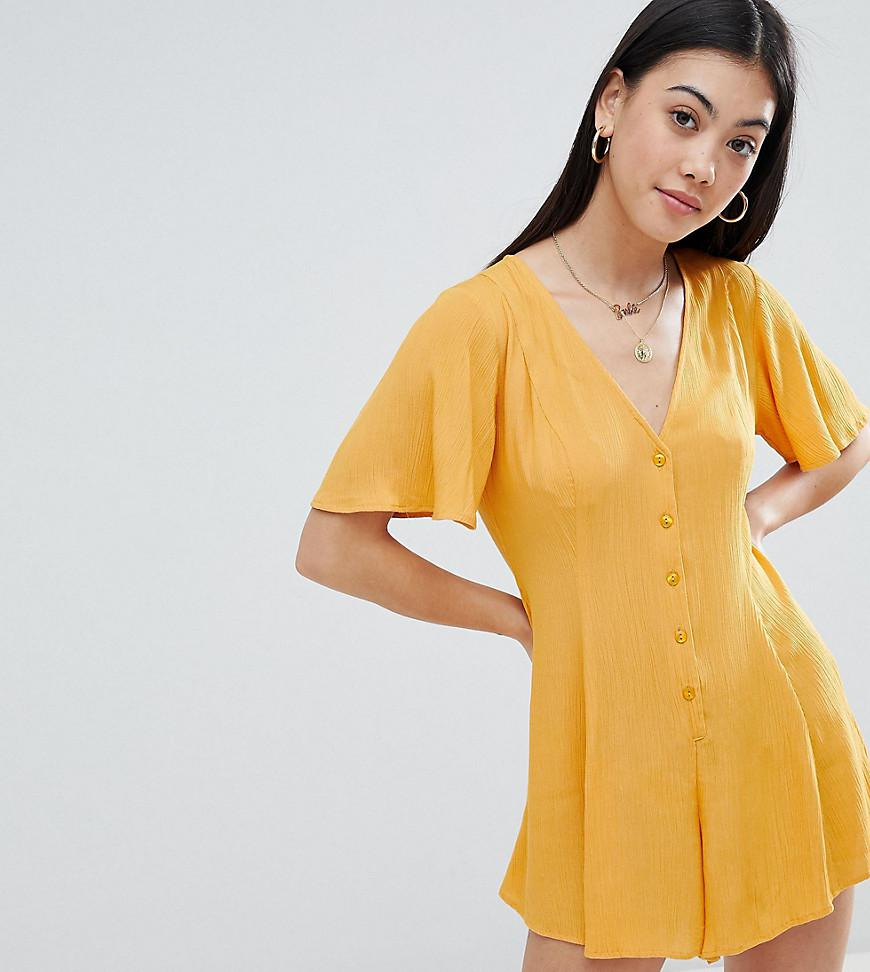 f85ce498476 ASOS Asos Design Petite Swing Romper With Button Detail in Yellow - Lyst
