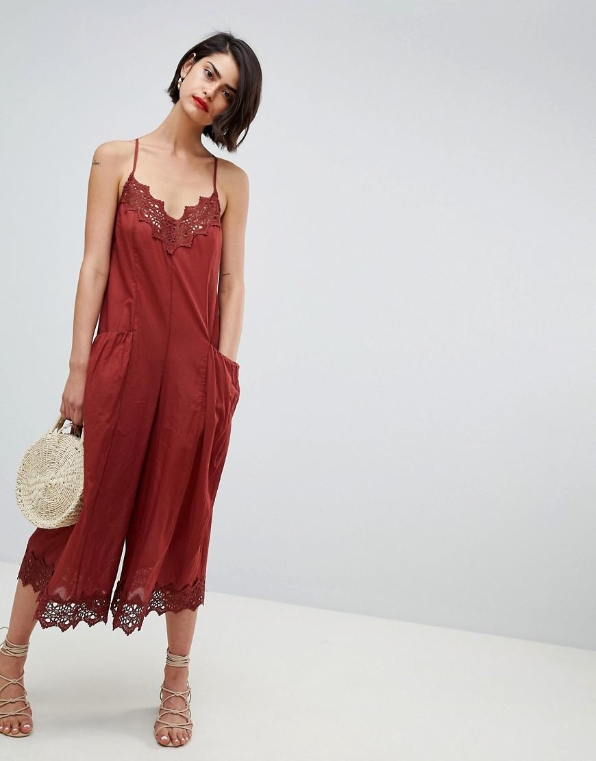73bf30b1cab ASOS Jumpsuit With Lace Trims And Oversized Pocket Detail in Red - Lyst