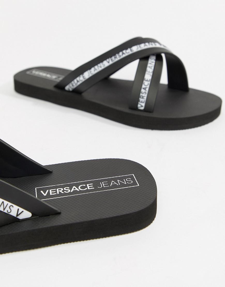 e38325c14924 Lyst - Versace Jeans Logo Cross Over Flip Flops In Black in Black ...
