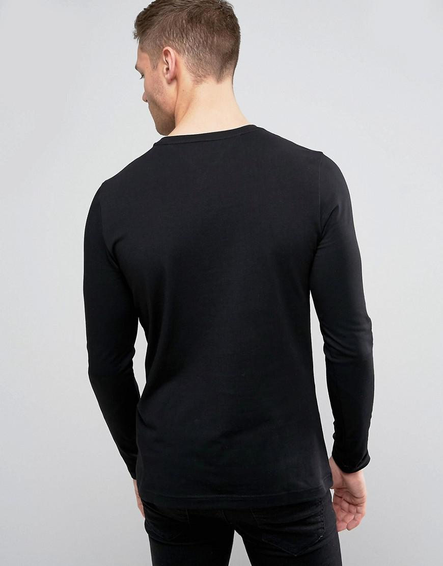 a71c75e85c592 Lyst - Tommy Hilfiger Long Sleeve Top Flag Logo In Black Exclusive At Asos  in Black for Men