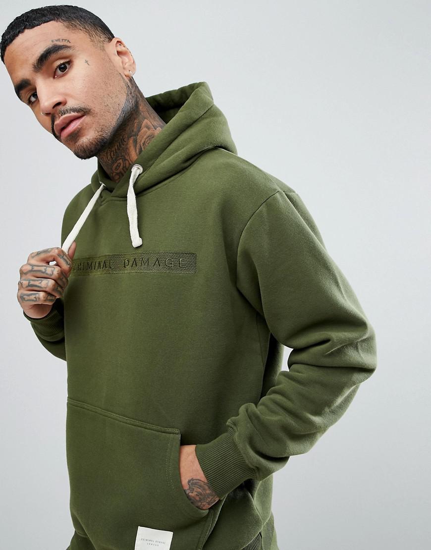 Criminal Damage. Men's Green Muscle Logo Hoodie In Khaki