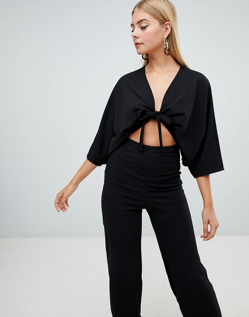 b962f469fd7b PrettyLittleThing Crepe Batwing Cut Out Jumpsuit in Black - Lyst