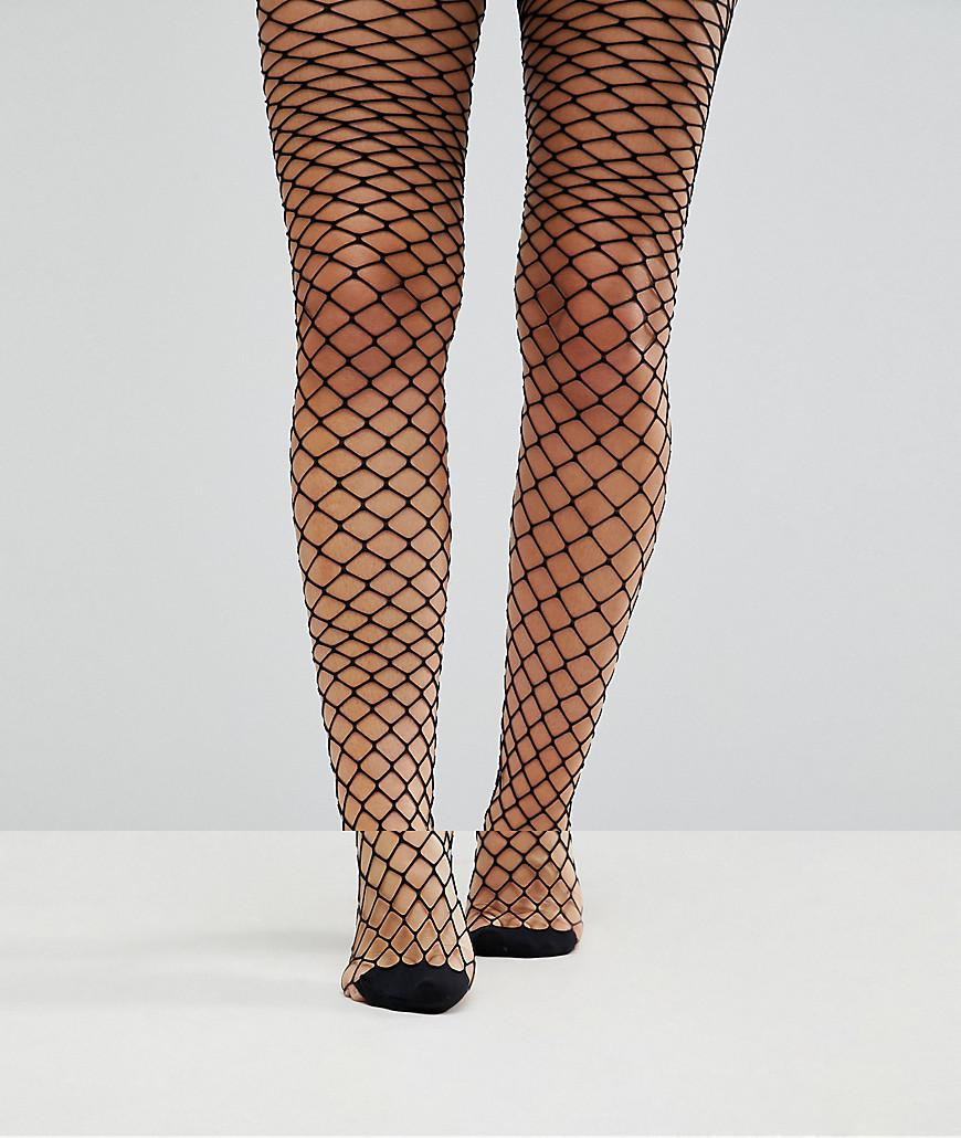 1a0ea6bfc6d39e ASOS Oversized Fishnet Tights in Black - Lyst