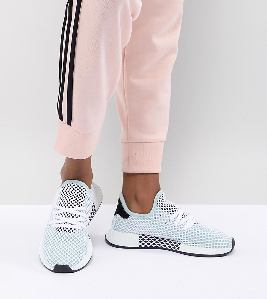 new style 1e9b3 8892a adidas Originals. Womens Black Deerupt Runner Sneakers In Green