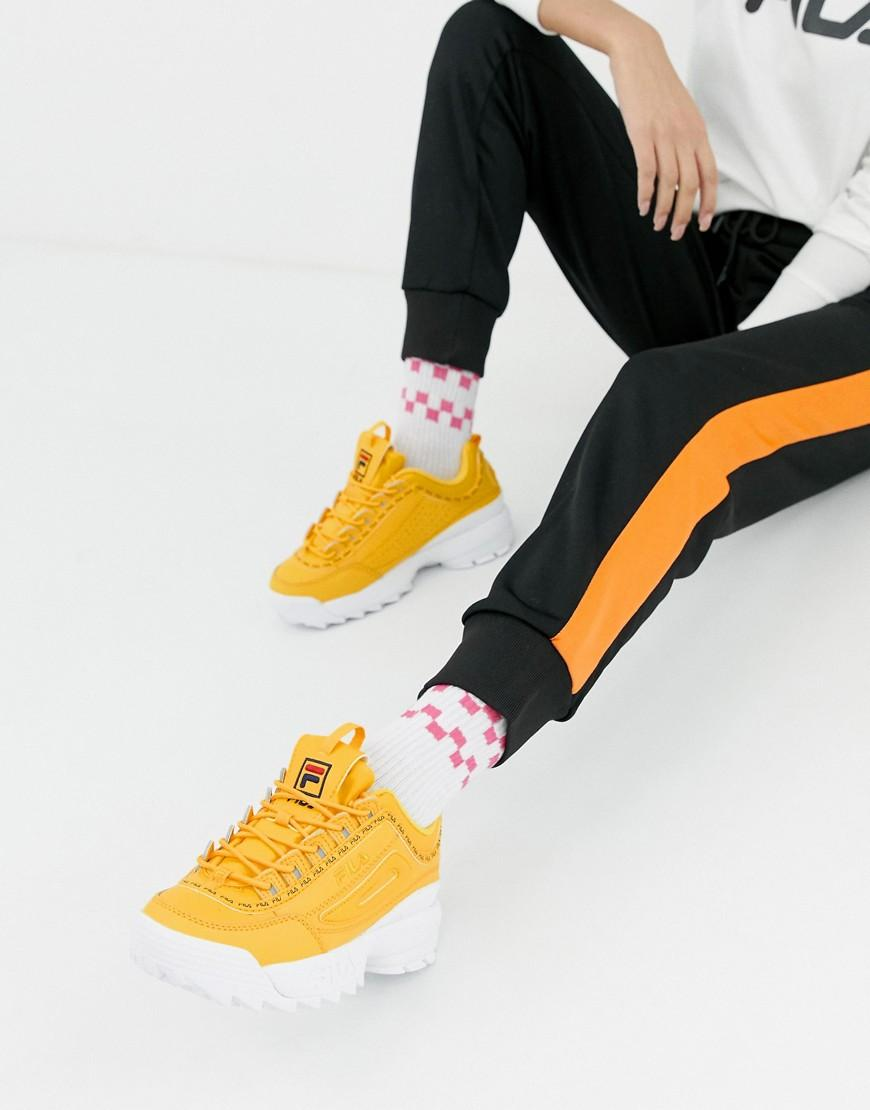 Fila. Zapatillas de deporte en amarillo con cinta del logo Disruptor 2  Premium de de mujer 23d87cb3b11