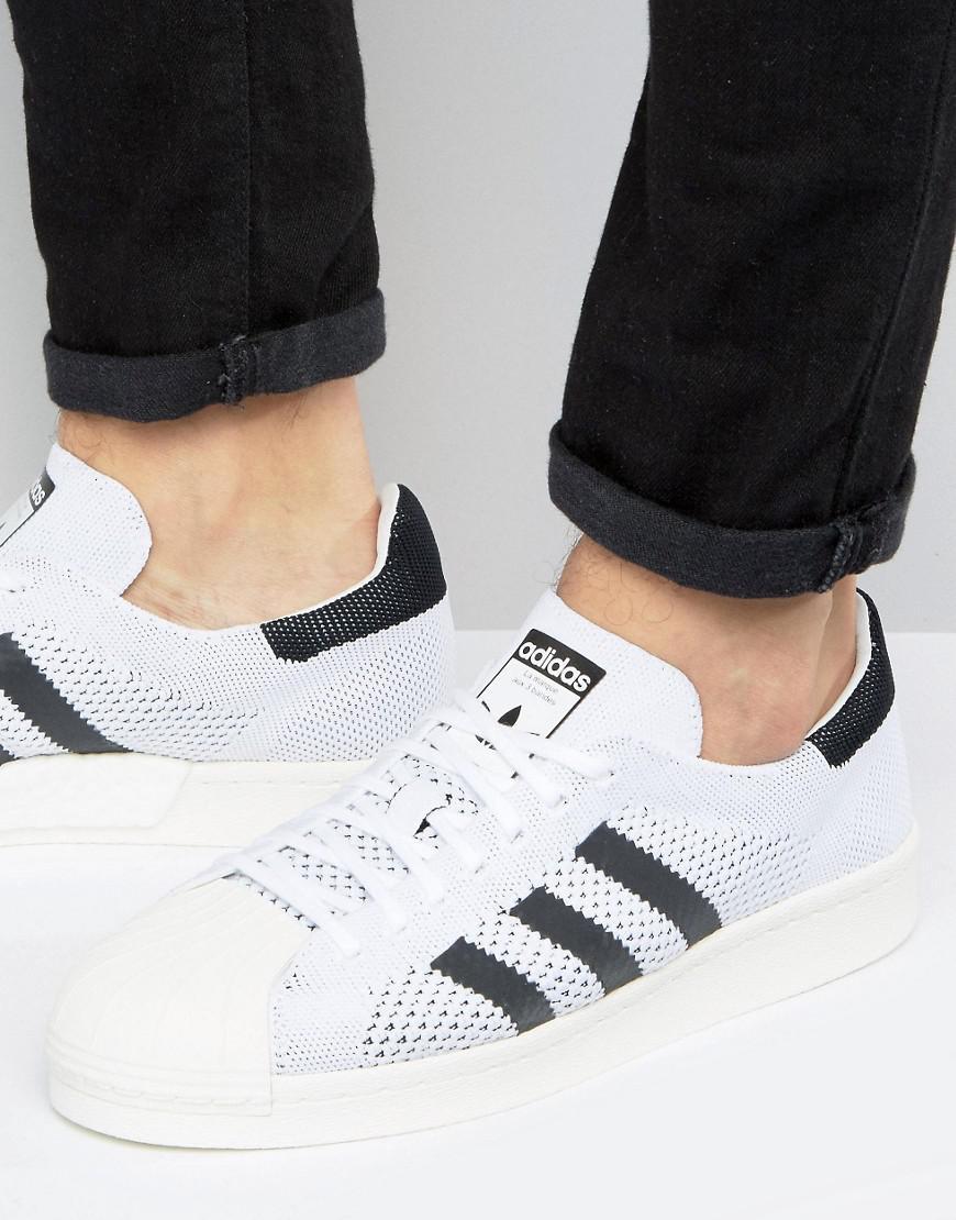 fb87fe425046 Lyst - adidas Originals Superstar Boost Primeknit Sneakers In White ...