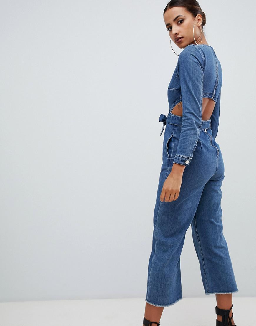 e869f54da8ad Missguided Cut Out Denim Jumpsuit In Blue in Blue - Lyst