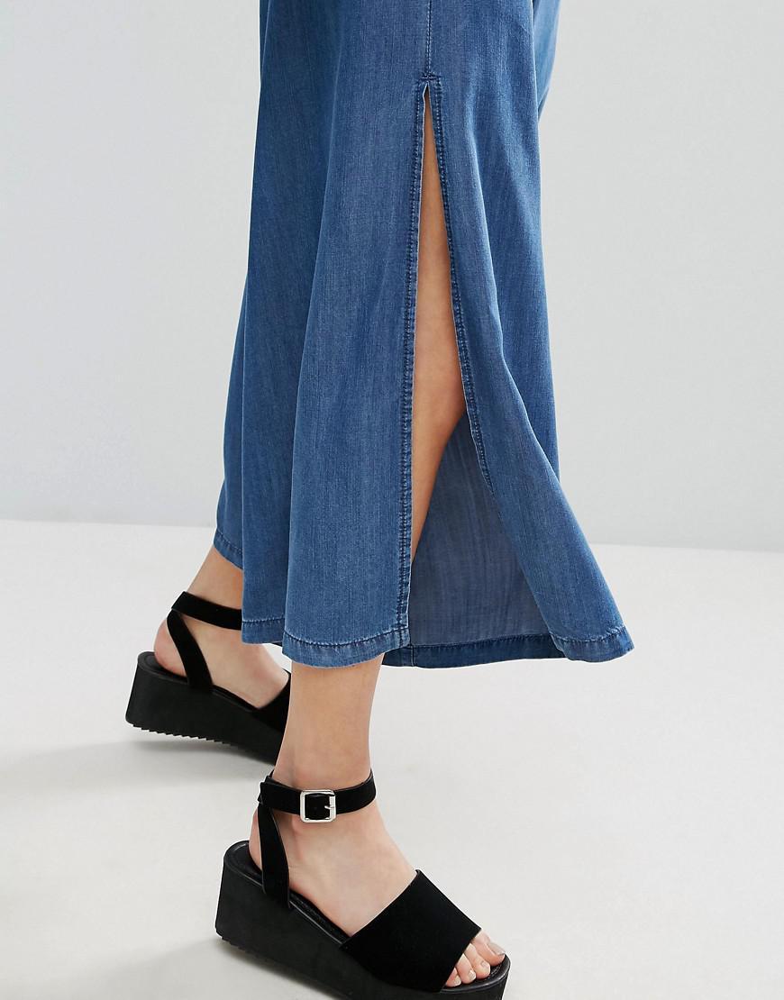 84fa4e807df6 Lyst - ASOS Denim Backless Jumpsuit With Split Culotte in Blue