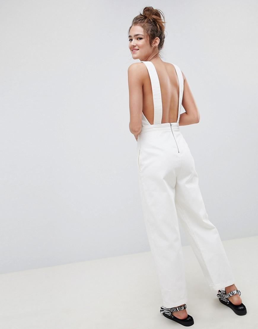 969cb274d9 Lyst - ASOS Denim Jumpsuit In White With Popper Detail in White