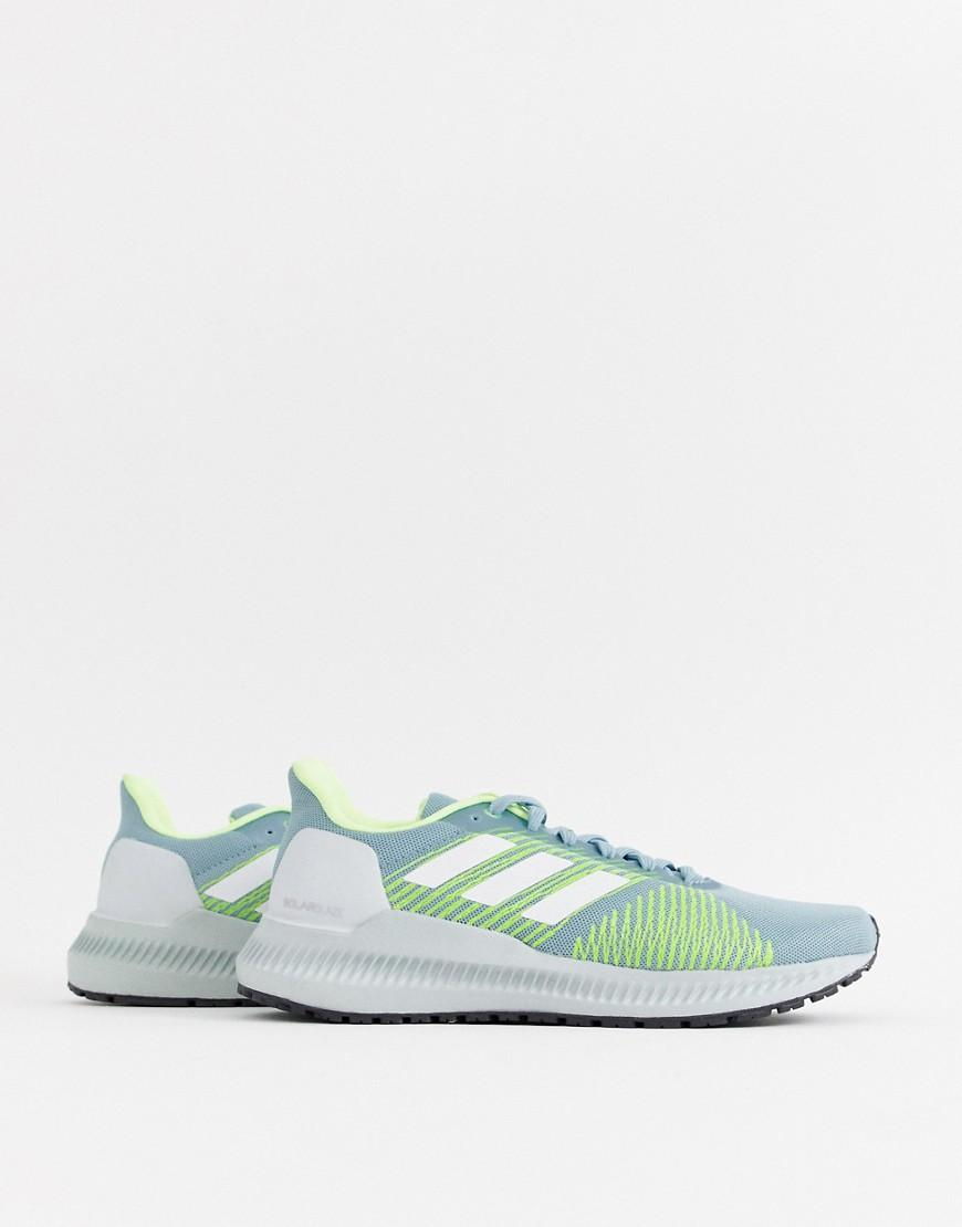 08389c2edcef adidas Running Solar Slaze Trainers In Grey And Lime - Lyst