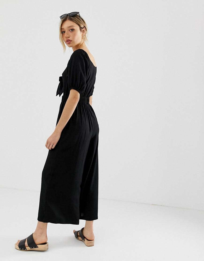 b26b9afca1a Lyst - ASOS Asos Design Petite Tea Jumpsuit With Puff Sleeve And Tie Detail  in Black