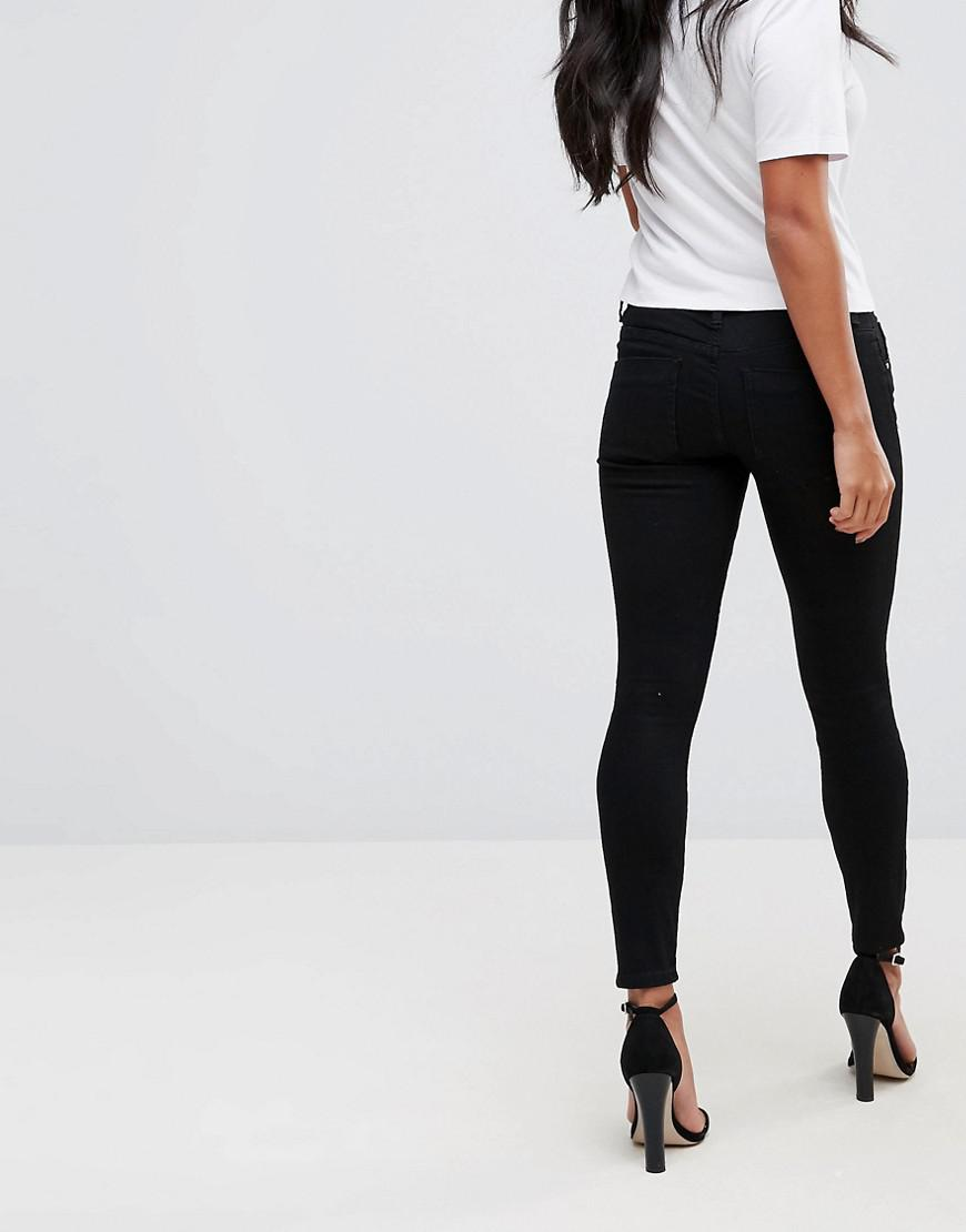 93f9ccb6bd9 ASOS Asos Design Petite Whitby Low Rise Skinny Jeans In Clean Black in Black  - Lyst