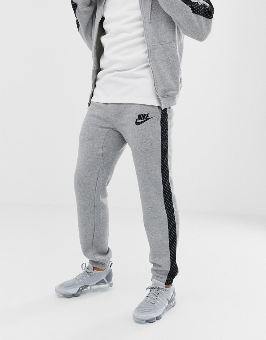 2e84277efc832 Nike Joggers With Striped Side Tape In Grey Bq0679-063 in Gray for ...