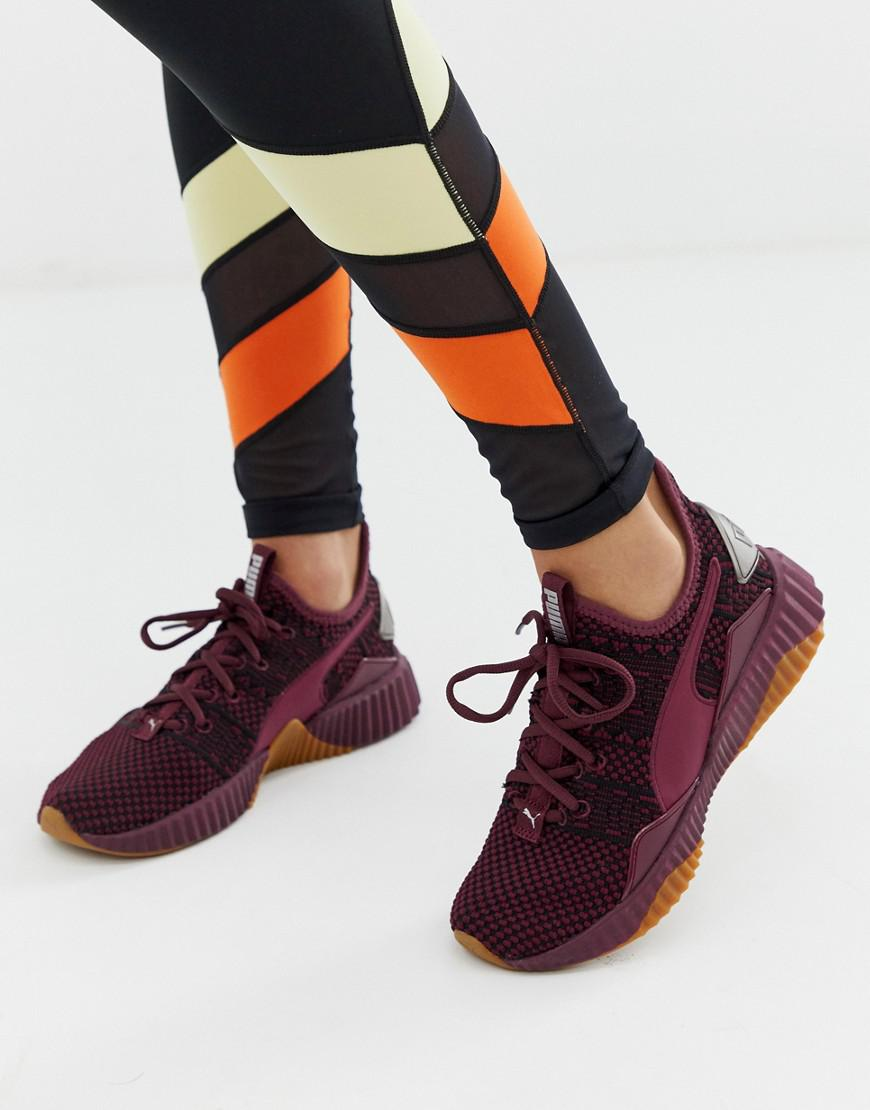 d5a672eea310 Puma Defy Sneakers In Burgundy in Red - Lyst