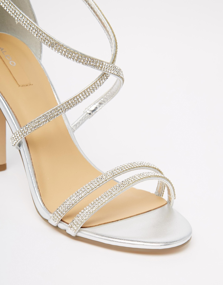 5ffe736d772 Lyst - ALDO Arenani Silver Cross Front Heeled Sandals in Metallic