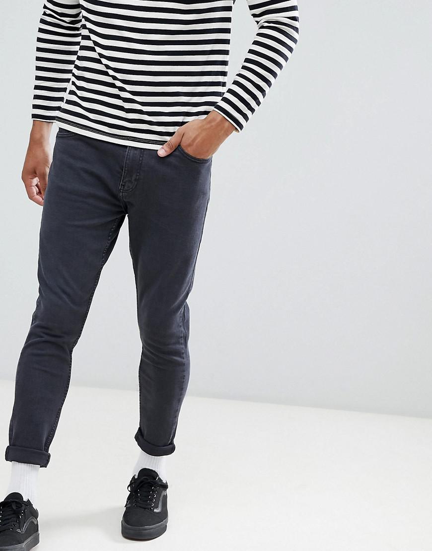 Jeans coupe carotte pour homme