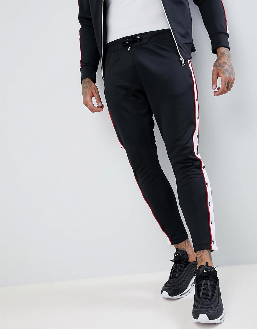 The Couture Club. Pantalon de jogging skinny moulant boutons-pression ... eef76401545