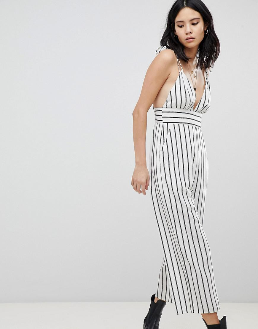 fb76f257cbb Honey Punch Plunge Front Jumpsuit In Stripe in White - Lyst