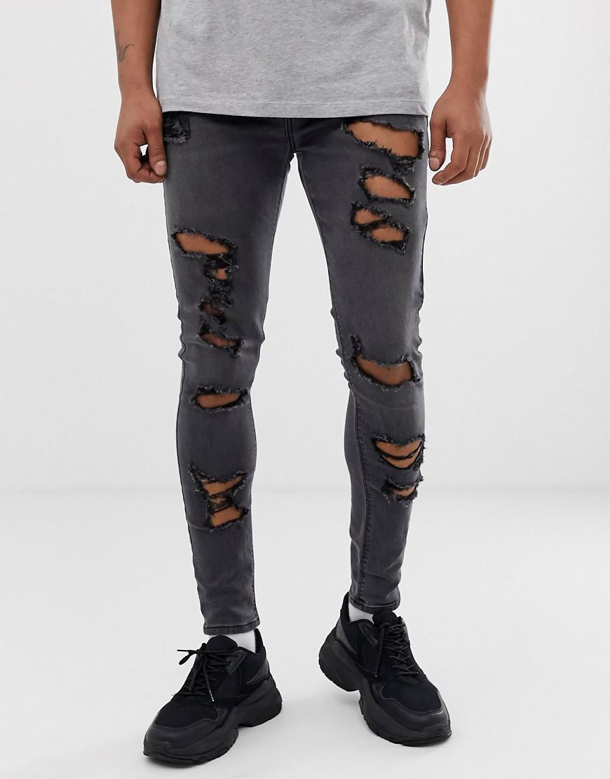 205124d89d6e7 ASOS - Spray On Jeans In Power Stretch With Heavy Rips In Washed Black for  Men. View fullscreen