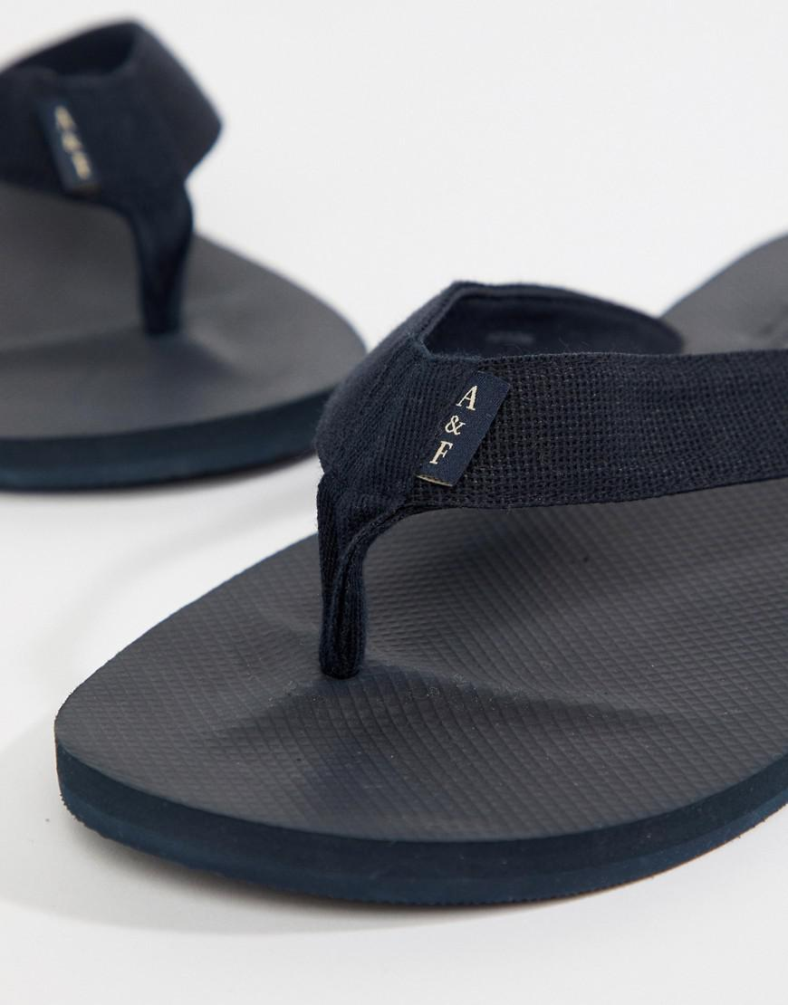 adda54b740bced Lyst - Abercrombie   Fitch Tab Logo Flip Flops In Navy in Blue for Men