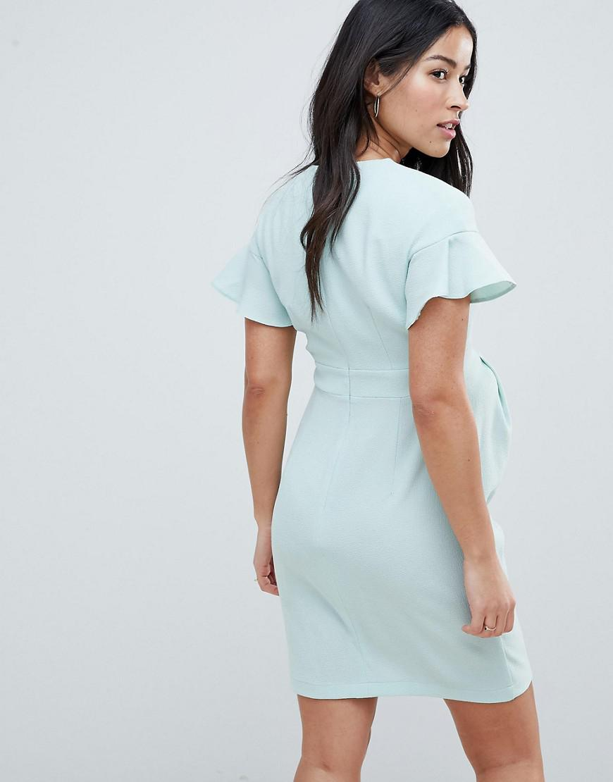 88fe4d5fa9 Asos Asos Design Maternity Mini wiggle Dress With Fluted Sleeve in Green -  Lyst