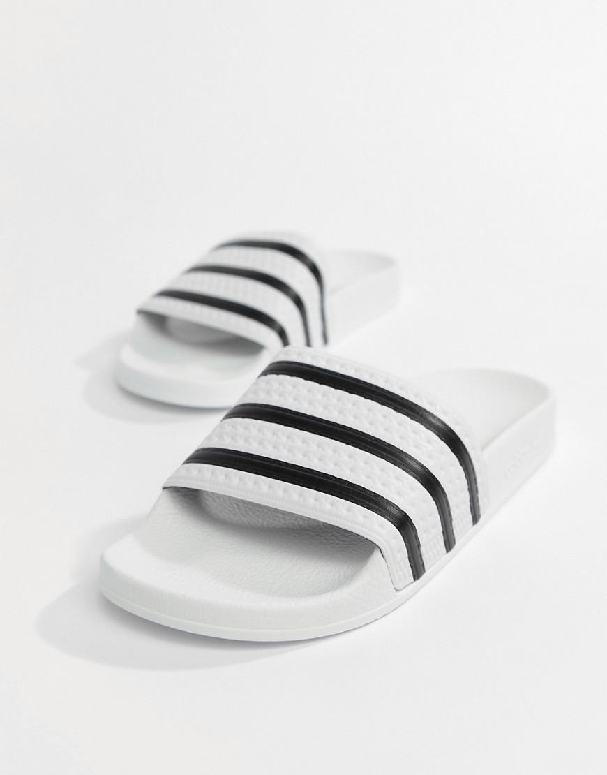 new product af1df e80ae adidas Originals. Men s Adilette Sliders In White 280648