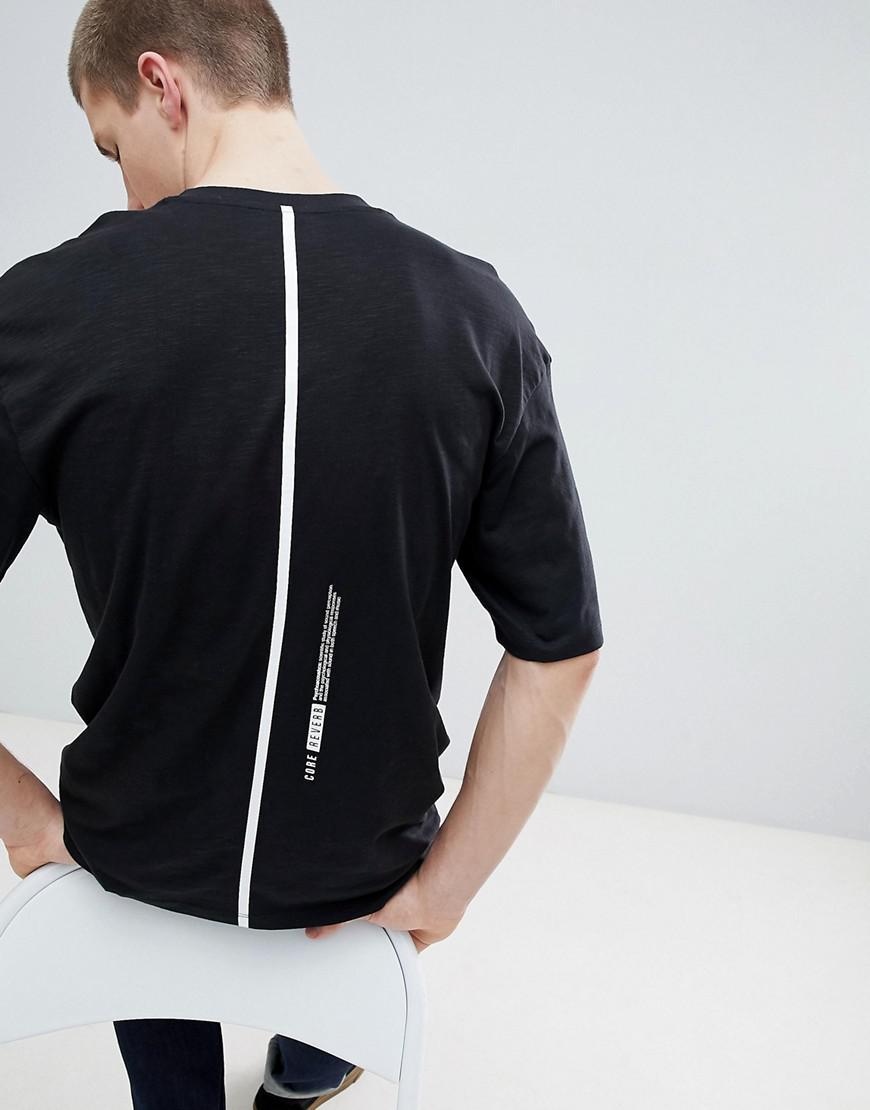 232c3bdbb4fa jack-jones-black-Core-Drop-Shoulder-T-shirt-With-Social-Industries-Graphic.jpeg